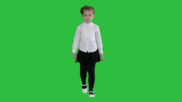 Thumbnail for Little serious girl walking towards camera on a Green Screen