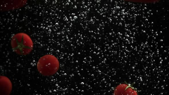 Thumbnail for Ripe Vegetables Cherry Tomatoes and Bell Pepper Falling Into Water Black Background