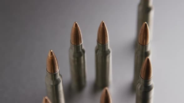 Cinematic rotating shot of bullets on a metallic surface - BULLETS 003
