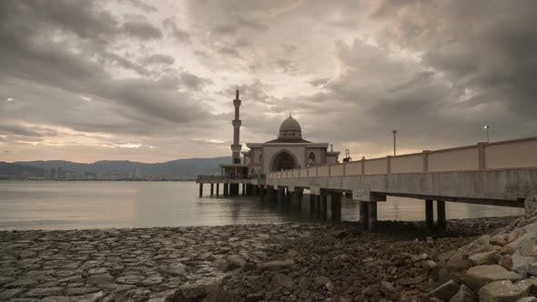 Timelapse cloudy sunset floating mosque