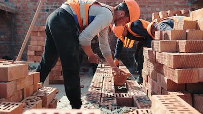 Builders Building a Brick Wall