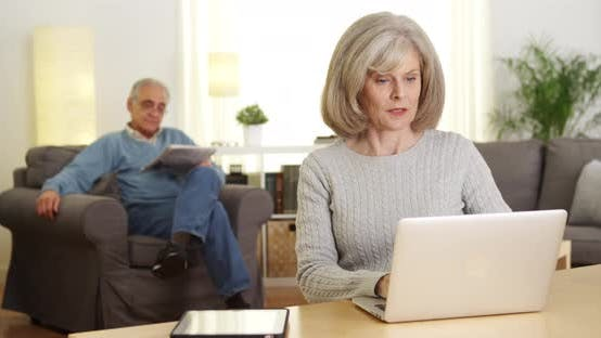 Thumbnail for Mature adults using laptop computer