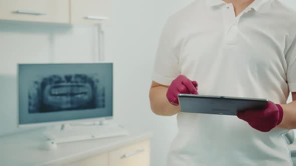 Hands of a Doctor Who Presses the Touch Buttons in a Tablet