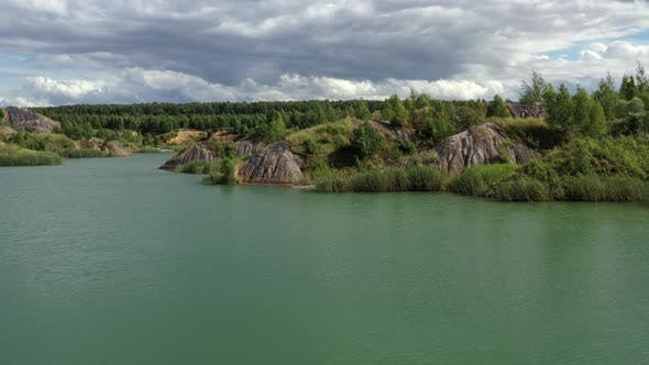 Thumbnail for Flying above the lake in the abandoned clay quarry
