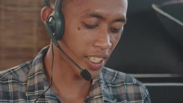 Thumbnail for Young Man Talking to Customer Using Headset
