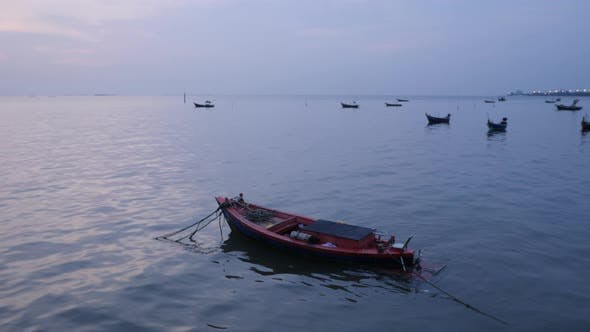 sea view with small local fishing boat anchored in the sea.