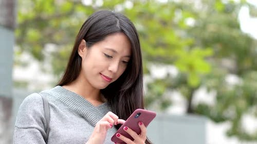Woman work on mobile phone at outdoor