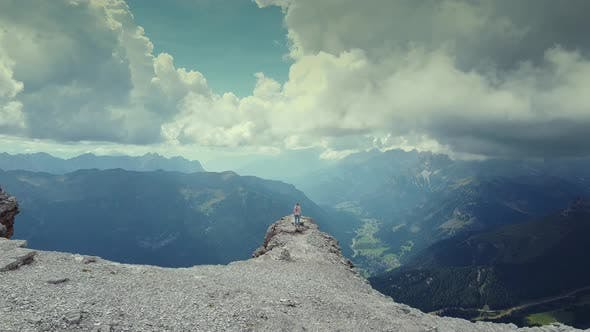 Thumbnail for Flying Over Woman Raising Hands on the Top of Piz Boe Mountain in Dolomites