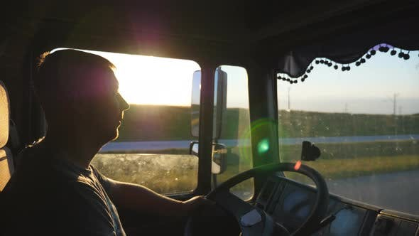 Thumbnail for Man Driving a Truck and Carefully Watching the Road. Caucasian Guy Is Riding Through the Countryside