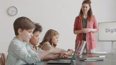 Children Using Laptop Computers in Classroom
