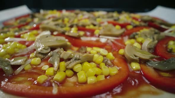 Thumbnail for Homemade Vegan Pizza with Mushrooms, Pepper, Corn and Olives Rotates on Table
