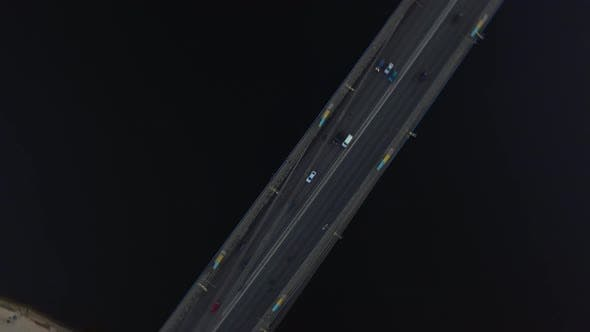 Thumbnail for Aerial View Car Moving on River Bridge in City. Car Traffic on Hanging Bridge