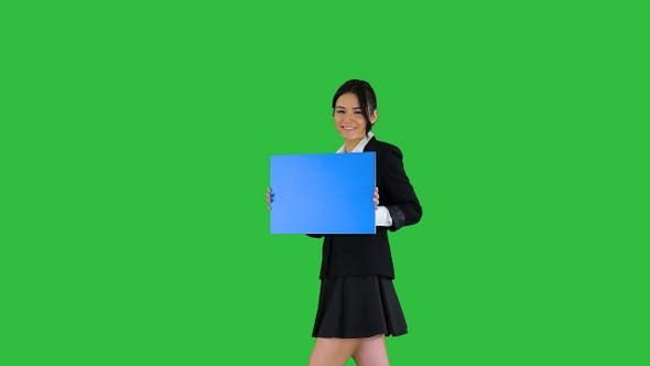 Thumbnail for Cute girl holding empty board announcing or presenting