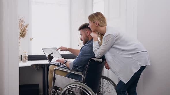 Thumbnail for Man in Wheelchair After Accident Remotely Working at Home Under Business Project
