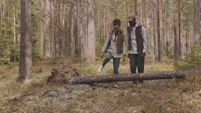 African-American Couple Walking in Forest
