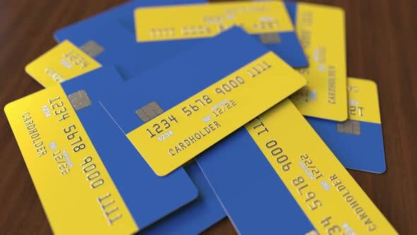 Cover Image for Pile of Credit Cards with Flag of Ukraine