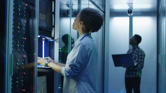 Thumbnail for Black Woman Working on Computer in Data Center