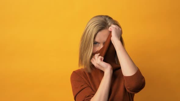 Thumbnail for Fresh Looking Model Wearing Turtleneck Sweater in Front of Yellow Background