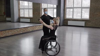 Middle Aged Pair in Face Masks Whirling in Dance