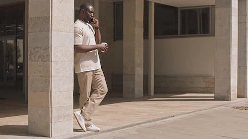Young Afro American Man in Casualwear Phone Calling Outdoors