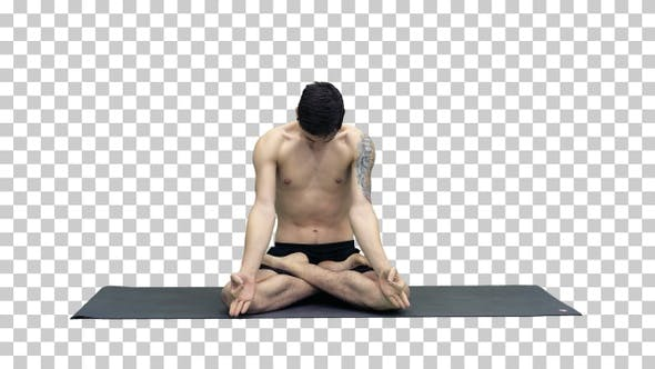 Thumbnail for Young man practicing yoga in lotus position, Alpha Channel