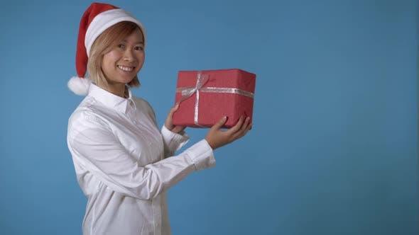 Thumbnail for Beautiful Girl Like Santa Holding Gift