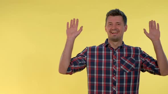 Thumbnail for Happy Young Man Covering His Face with Hands, Then Opening It and Smiling.