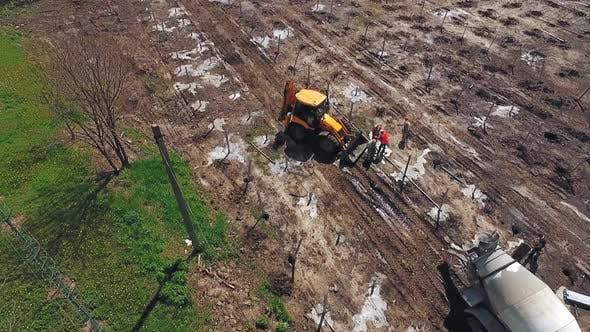 Excavator working on field. Industrial excavator during construction works