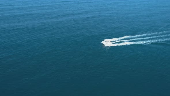 Aerial View of Luxury White Speed Boat Cruising in the Blue Calm Sea