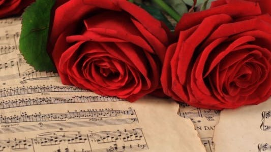 Thumbnail for Red Roses on Vintage Sheet Music