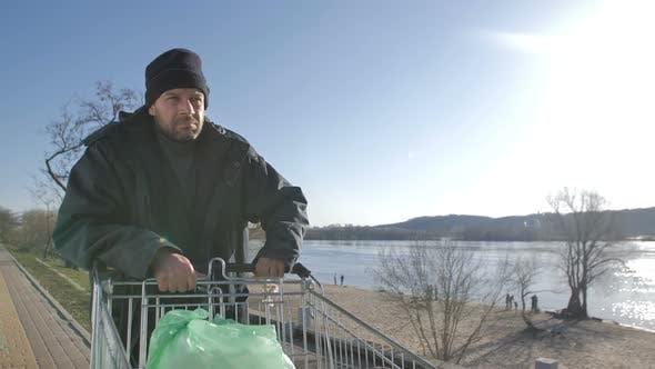 Thumbnail for Portrait of Mature Homeless Man Walking Near River