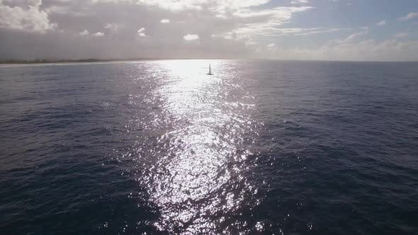 Thumbnail for Aerial Shot of Sailing Yacht in Bright Sunlight