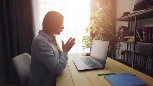 Woman Using Laptop for Communication