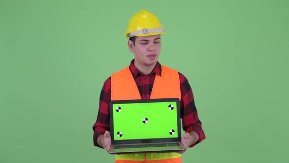 Thumbnail for Stressed Young Multi Ethnic Man Construction Worker Showing Laptop