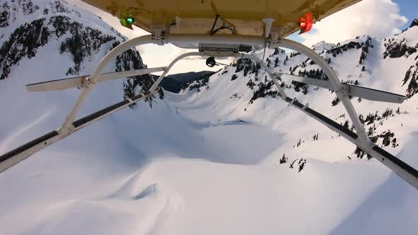 Thumbnail for Helicopter Flying Three Fingers Cascade Mountains Snowy Pointed Peaks Frozen Lakes Dropoff