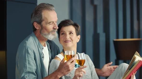 Aged Couple Drinking Wine