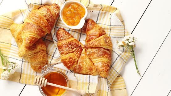 Croissants and Condiments Composition on the Table
