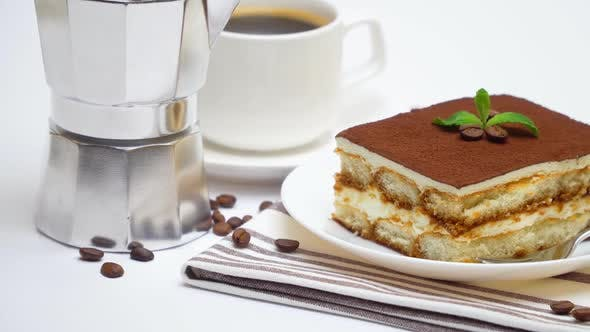 Tiramisu Dessert Portion, Mocha Coffee Maker and Cup of Fresh Espresso Coffee on White Background
