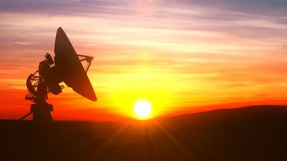 Cover Image for Radio Telescope Explores Evening Sky Against Scenic Sunset