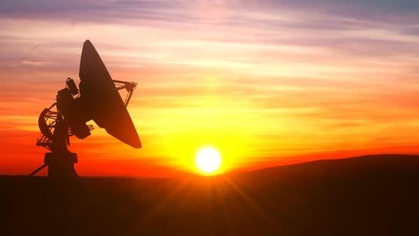 Thumbnail for Radio Telescope Explores Evening Sky Against Scenic Sunset