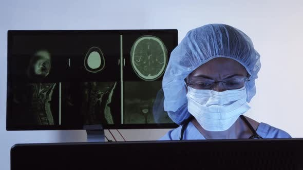 Surgeon Diagnosing CT Of Brain On Computer 15