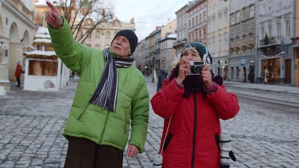 Thumbnail for Senior Old Couple Tourists Grandmother Grandfather Walking in City Taking Photo Pictures on Camera