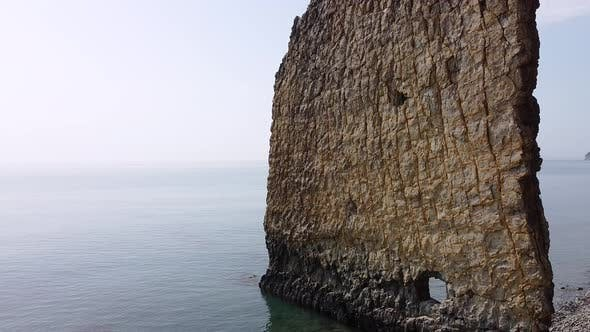 An unusual rock standing in the sea