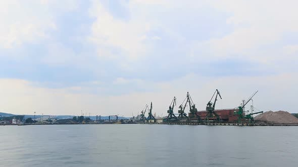 Thumbnail for Huge industrial cranes at sea port, cargo transportation, shipbuilding, business