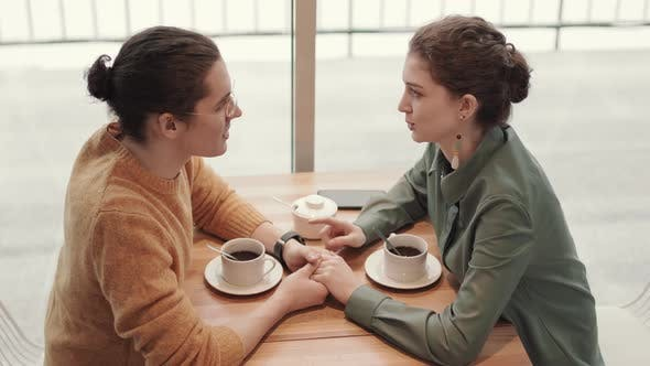 Couple Meeting in Coffee House