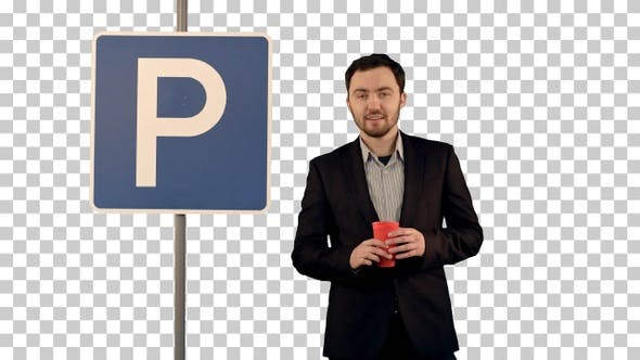 Man with cup of tea near parking sign, Alpha Channel