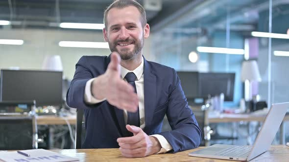 Thumbnail for Cheerful Young Businessman Offer Shaking Hand in Office