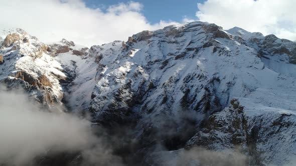 Thumbnail for Rocky Foggy Mountain Peak In Snowy