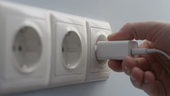 Thumbnail for Hand Connecting Electric Plug Usb Charger Into A Wall Socket Concept Of Saving Energy