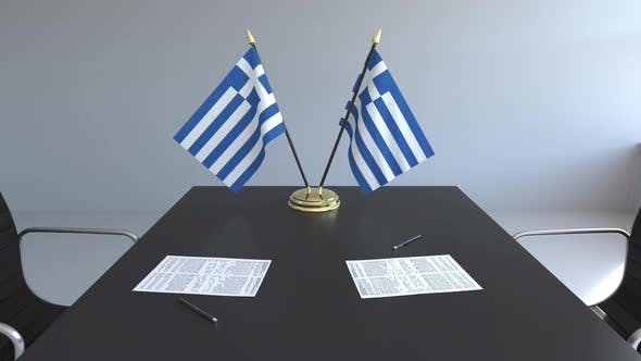 Thumbnail for Flags of Greece and Papers on the Table